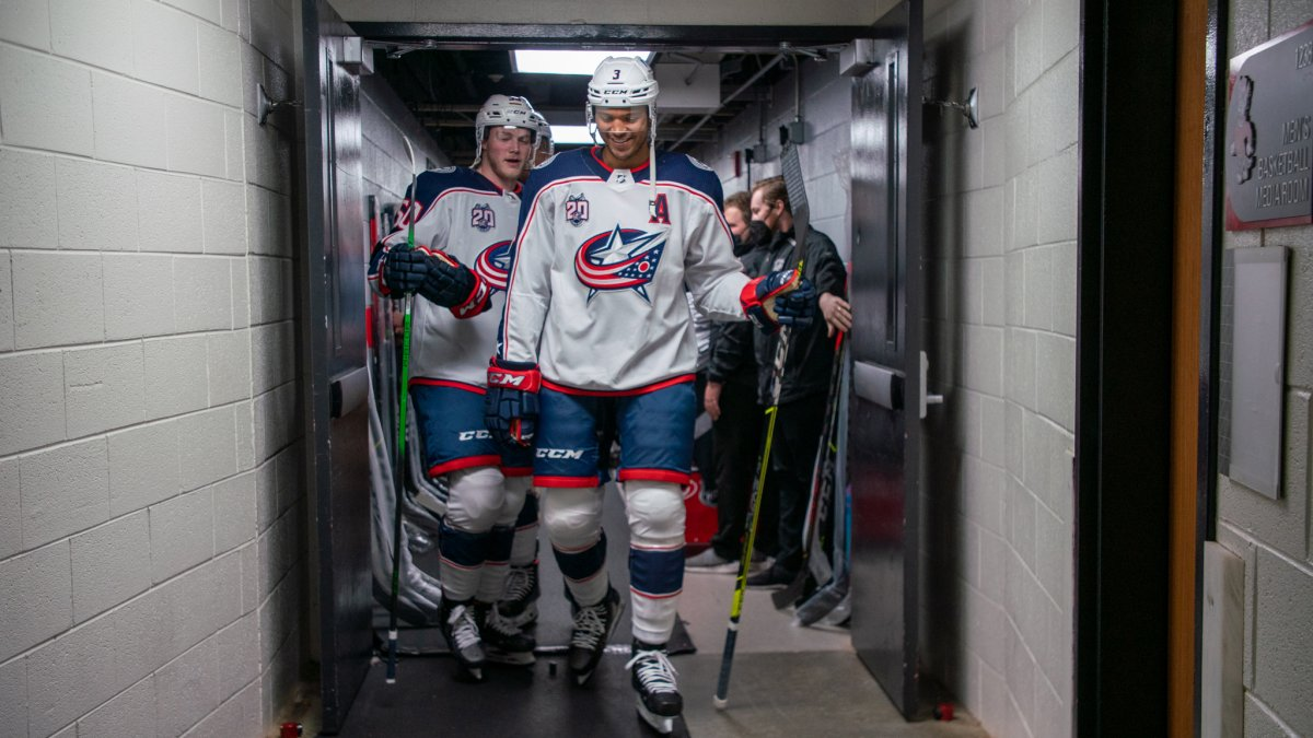 Seth Jones sports the white and navy combo before the Blue Jackets take the ice.