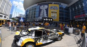 Outside of Bridgestone Arena, Predators' fans beat up on a Penguins car