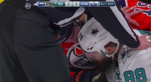 Patrick Maroon feels up Brent Burns beard after play is stopped
