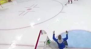 An ice worker tried to avoid pucks while hockey players from Czech Republic-Sweden warmup