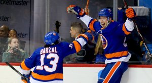 Mat Barzal celebrates a goal with his teammates