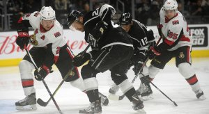 Dion Phaneuf tries to shield away Marian Gaborik during a Senators-Kings game