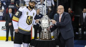 Vegas Golden Knights defenseman Deryk Engelland with NHL deputy commissioner Bill Daly