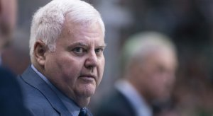 Ken Hitchcock looks on from the bench over his players for the Dallas Stars.