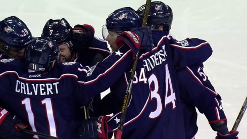 Blue Jackets celebrate a goal against the Penguins.