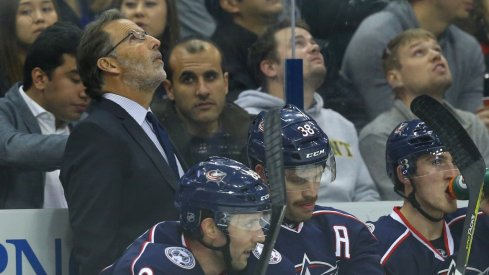 John Tortorella looks up at the scoreboard during a home game.