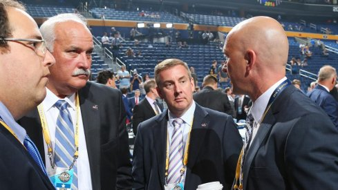 John Davidson and Jarmo Kekalainen talk at the draft
