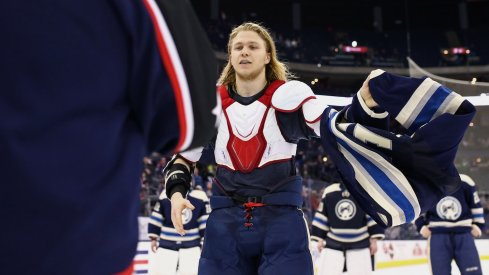 William Karlsson removes his jersey as the team gives their jerseys off of their backs.