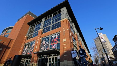 Columbus Blue Jackets' fans get ready to enter Nationwide Arena for a game.