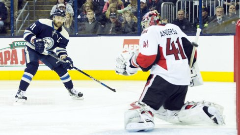 Nick Foligno takes a shot on Senators goalie Craig Anderson