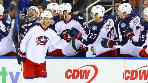 Alex Wennberg swings by the benches to celebrate after a goal.