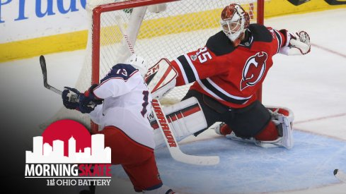 Cam Atkinson tries to get the puck past Cory Schneider