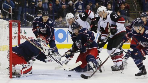 Sergei Bobrovsky scrambles to cover up the puck against a feisty Arizona Coyotes team