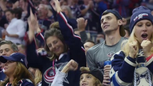 Fans celebrate a goal during the Blue Jackets new January opening video