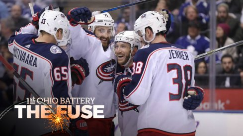 Blue Jackets celebrate a goal from Nick Foligno in the third period