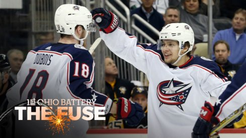 Artemi Panarin and Pierre-Luc Dubois celebrate a goal against the Penguins.