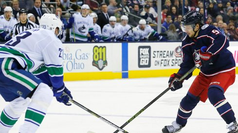 Artemi Panarin carries the puck against the Vancouver Canucks.