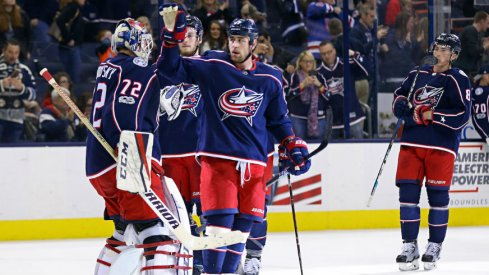 Blue Jackets celebrate a win with goaltender Sergei Bobrovsky at Nationwide Arena