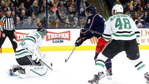 Artemi Panarin tries to put the puck past Stars goaltender Ben Bishop