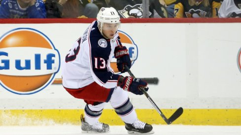 Cam Atkinson tries to enter the zone against the Pittsburgh Penguins
