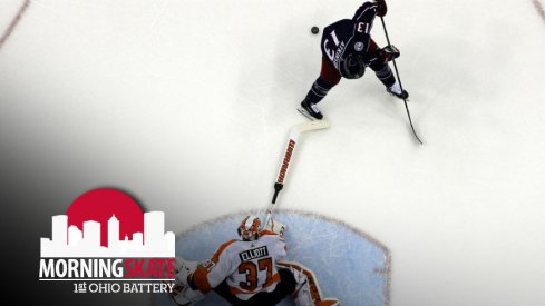 Cam Atkinson attempts to sneak one by Brian Elliott of the Flyers in the shootout