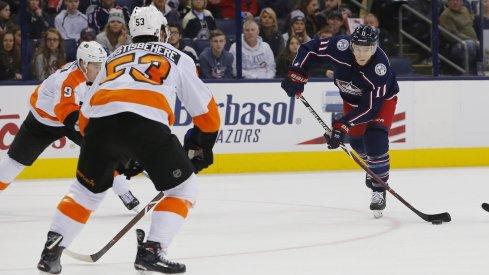 Matt Calvert gets a shot off between a couple of Philadelphia Flyers