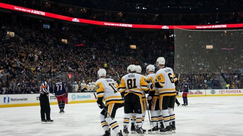 The Pittsburgh Penguins celebrate scoring a goal during the first period of their game against the Blue Jackets