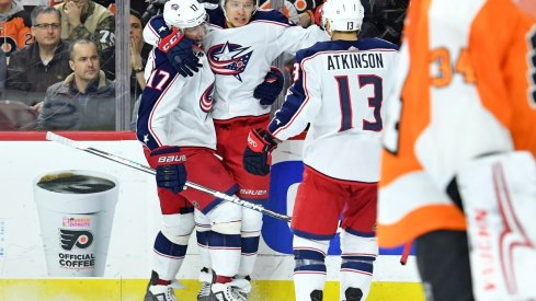 Artemi Panarin celebrate scoring against the Flyers