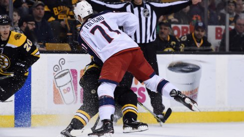 Blue Jackets captain Nick Foligno lays a huge hit on Bruins forward Brad Marchand