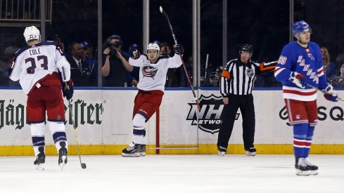 Artemi Panarin celebrates after scoring one of his three goals