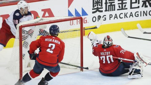 Pierre-Luc Dubois tries to put a puck past Braden Holtby during Game 5
