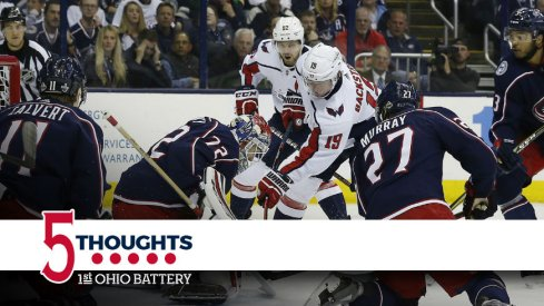 The Blue Jackets surround Sergei Bobrovsky in hopes of preventing a goal