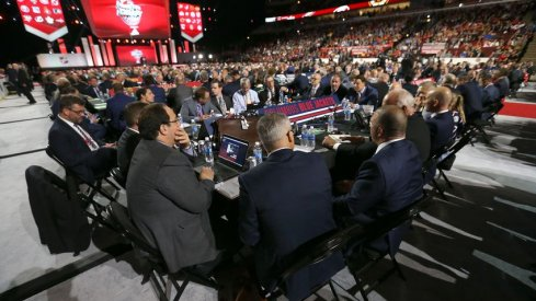 Jarmo Kekalainen, John Davidsson and Blue Jackets scouts discuss things at their draft table