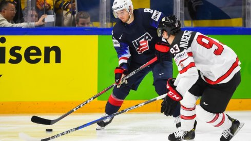 Cam Atkinson tries to out maneuver Ryan Nugent-Hopkins during the 2018 World Championship Bronze Medal game