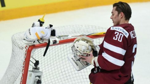 Elvis Merzlikins gets ready for a game as a goaltender for Latvia