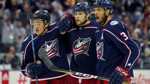 Seth Jones, Josh Anderson and Sonny Milano celebrate a Blue Jackets goal against the Washington Capitals.