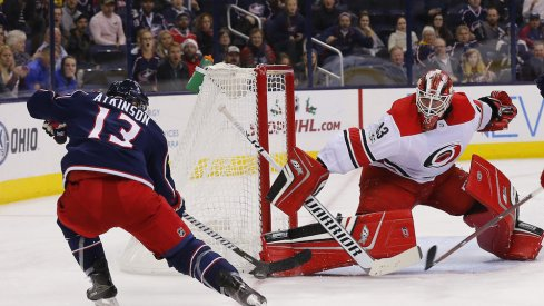 Columbus Blue Jackets forward Cam Atkinson tries to beat Hurricanes goaltender Scott Darling during a game at Nationwide Arena.