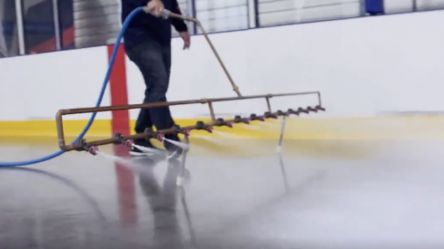 Ice technician Ian Huffman begins to lay a new sheet of ice at the OhioHealth Ice Haus.