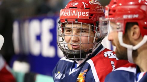 Alexandre Texier talks on the bench during a game