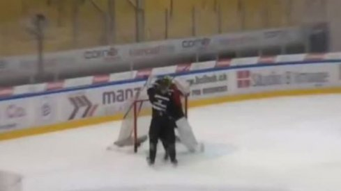 Elvis Merzlikins fights in practice with a fellow HC Lugano teammate