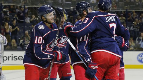 Alexander Wennberg and the Columbus Blue Jackets celebrate a power play goal scored against the Chicago Blackhawks at Nationwide Arena.