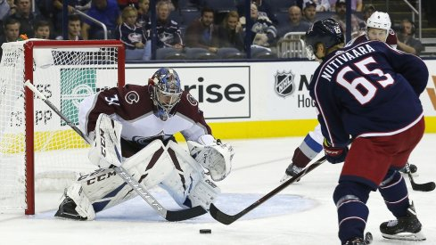 Columbus Blue Jackets defenseman Markus Nutivaara takes a shot on goal against Colorado Avalanche goaltender Philip Grubauer at Nationwide Arena.