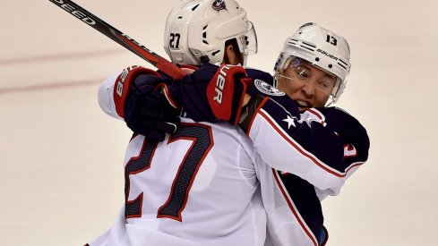 Cam Atkinson and Ryan Murray celebrate scoring against the Panthers