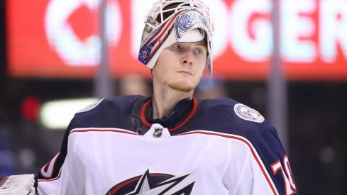 Columbus Blue Jackets goaltender Joonas Korpisalo looks on during a game against the Toronto Maple Leafs.