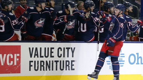 Liam Foudy celebrates scoring a pre-season goal for the Blue Jackets