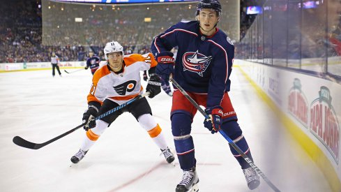 Columbus Blue Jackets defenseman Zach Werenski protects the puck against the Philadelphia Flyers at Nationwide Arena.