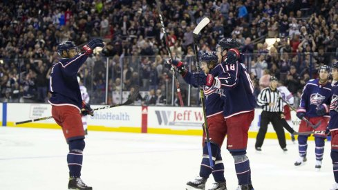 The Columbus Blue Jackets celebrate a goal scored by Pierre-Luc Dubois against the New York Rangers at Nationwide Arena.