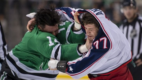 Jamie Benn and Josh Anderson fight early during the Blue Jackets and Stars game.