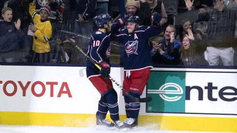 Cam Atkinson and Alexander Wennberg celebrate scoring against the Toronto Maple Leafs