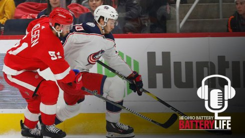 Alex Wennberg skates past Frans Nielsen in a matchup between the Detroit Red Wings and Columbus Blue Jackets
